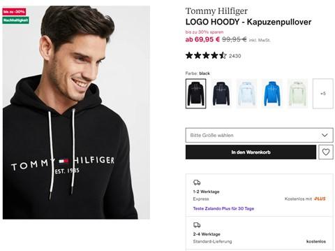 EIn männliches Model trägt einen Pullover.